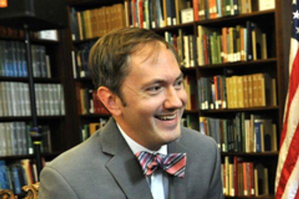 Environmental photo of R. Scott Crichlow in front of bookshelves