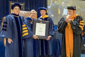December Commencement speaker Wes Bush receives an HDR from WVU President E Gordon Gee and faculty December 15, 2017.