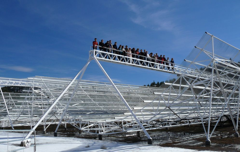A group of people standing on a high platform