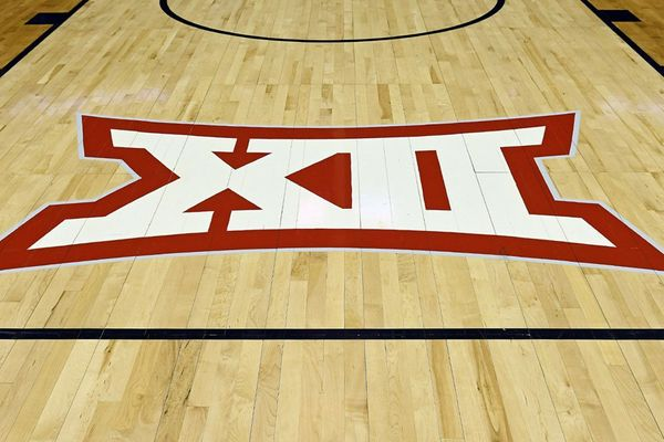 white XII outlined in red on basketball court