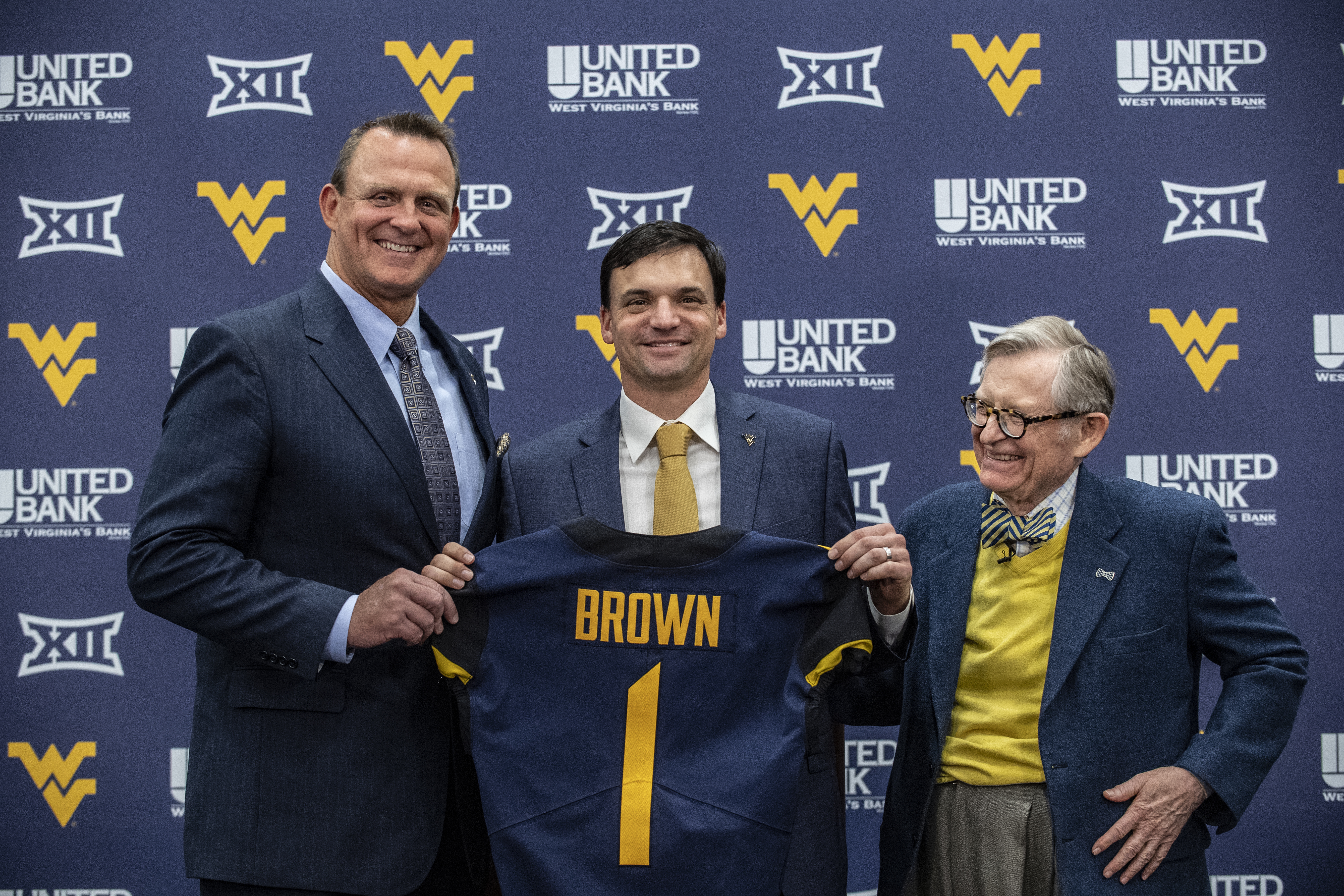 WVU Athletic Director Shane Lyons (L) with new football coach Neal Brown (C) and WVU President Gordon Gee (R)