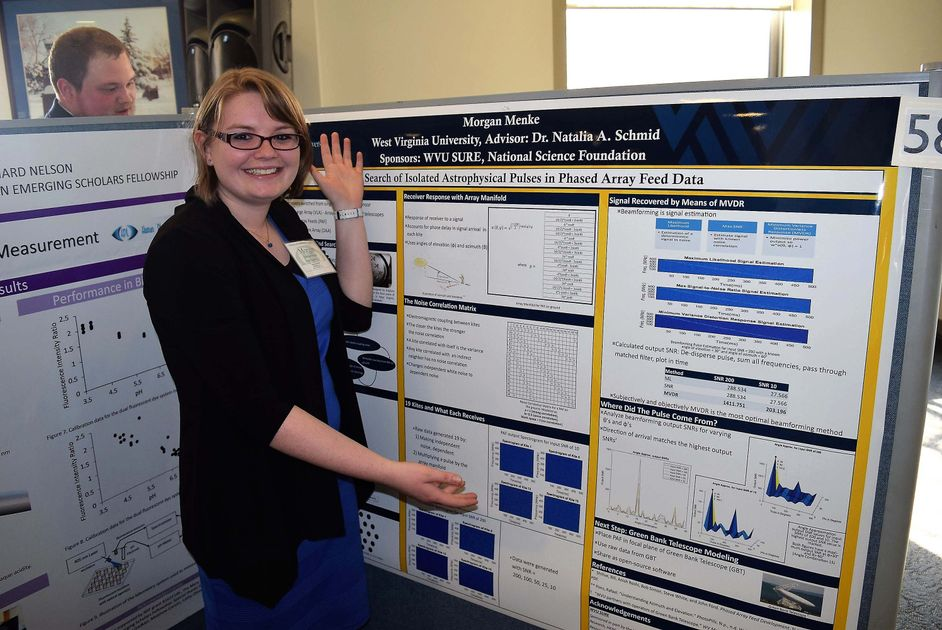 Morgan Menke, standing with her presentation board for Capitol Hill