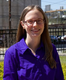 Woman in a purple shirt with glasses