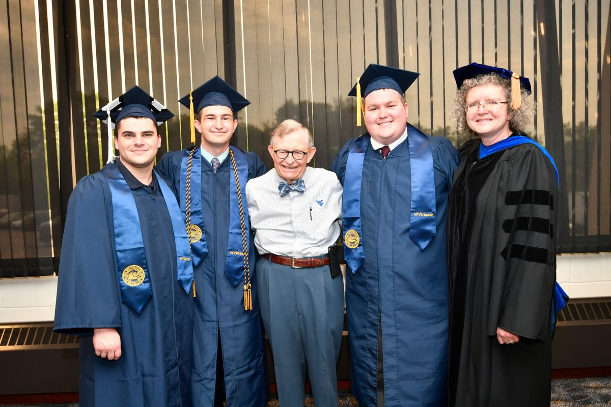 Gordon Gee and Gay Stewart with three WVUteach grads in caps and gowns