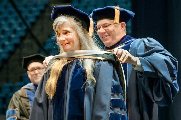 Photo of Ann Pancake receiving honorary doctorate at Eberly Commencement
