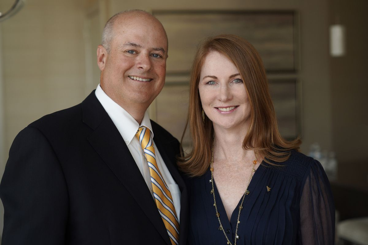 photo of smiling man and woman
