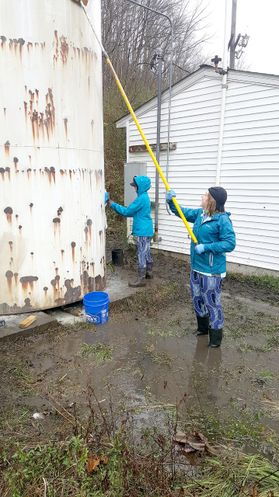 Rain from a recent storm forced the students to work in nearly knee-deep water.