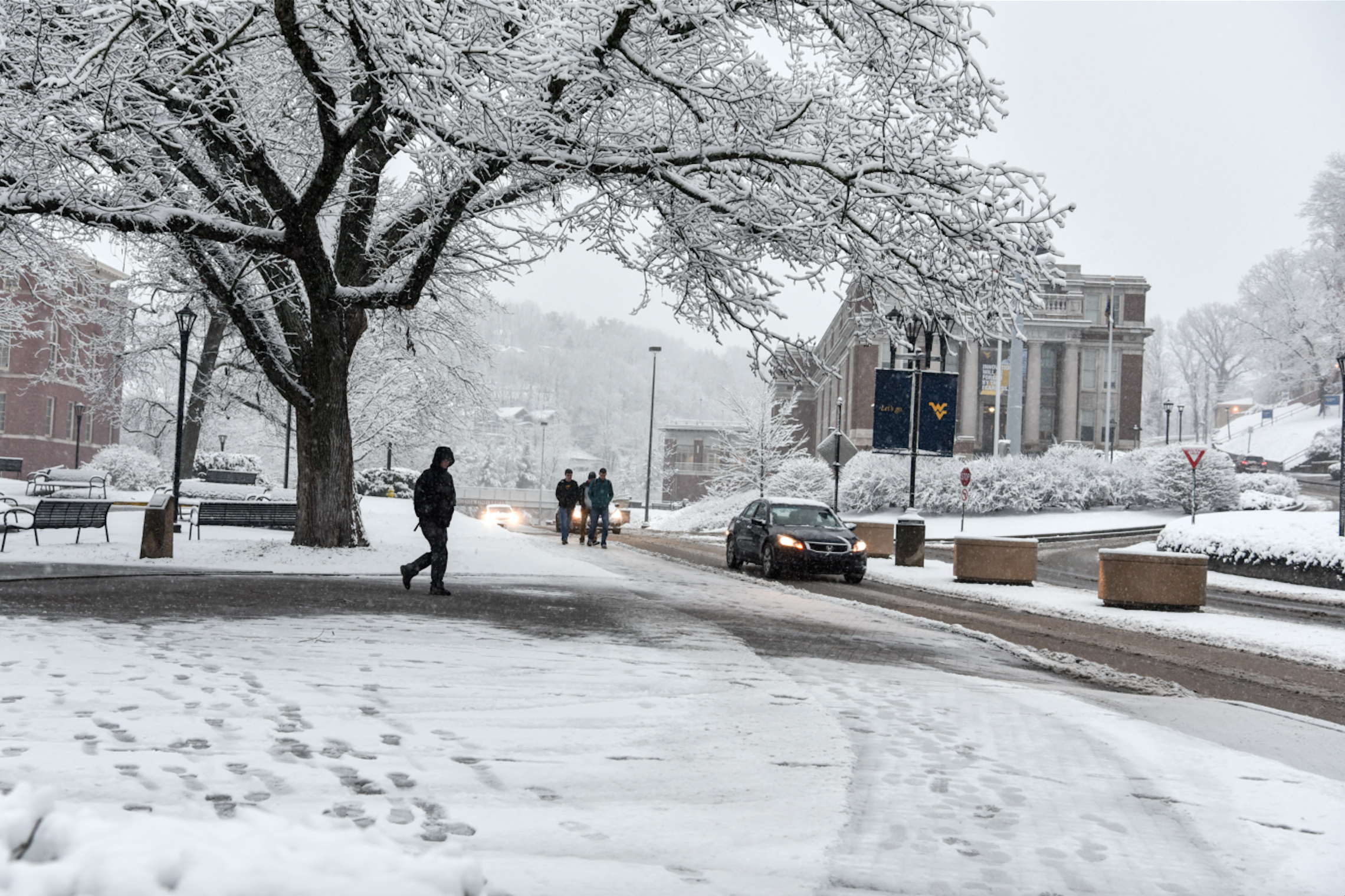 Students walk across a snowy WVU downtown campus.
