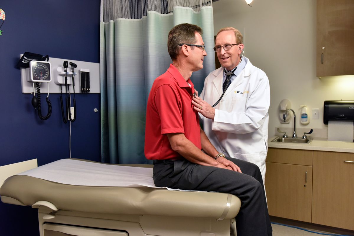 a doctor checks a male patient