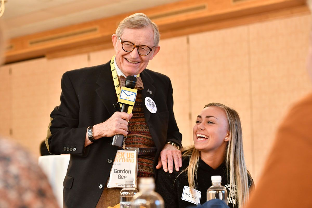 Gordon Gee laughing with a student in Wheeling West Virginia.