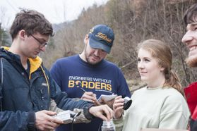 Morgan King, third from left, led a team of EWB members on a trip to Prenter.