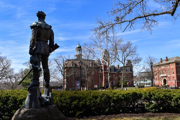 Mountaineer man statue looks out to Woodburn Circle