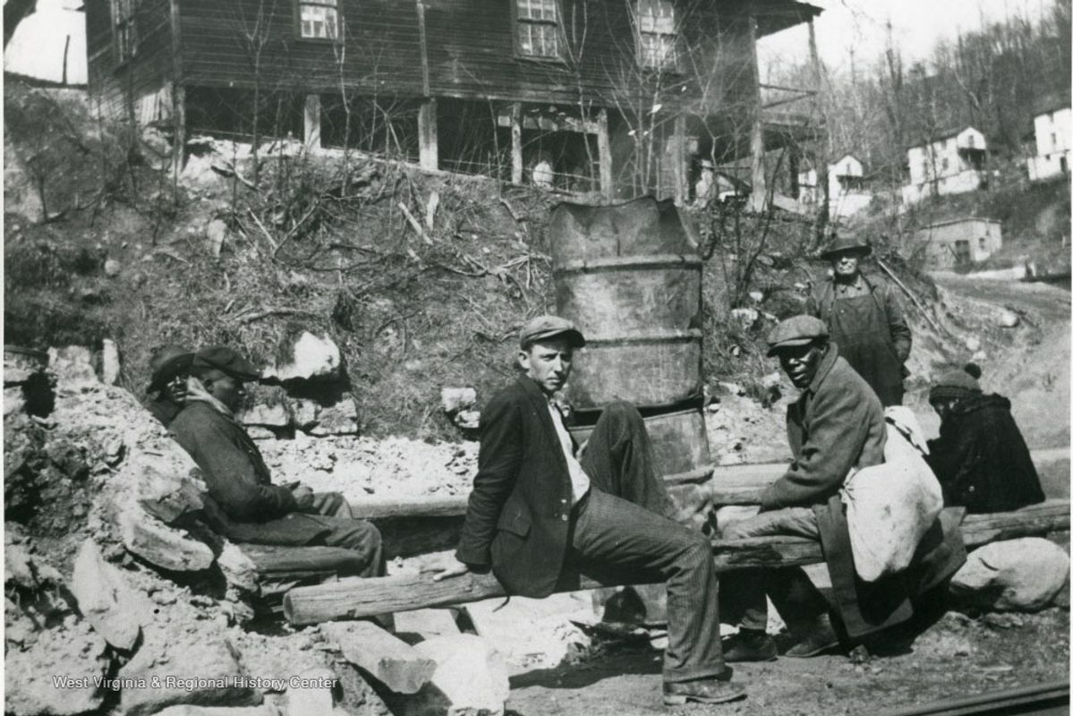 black and white photo of men on a picket line during