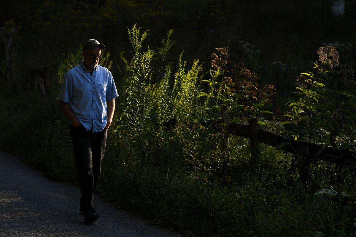 A man walks in the shadows