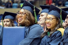 WVU Pathologists assistants Dominique Johnson and Chestia Long listens to speakers at the WVU commencement December 15, 2017.