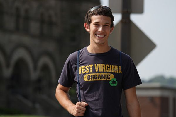 Smiling boy in a WVU shirt.