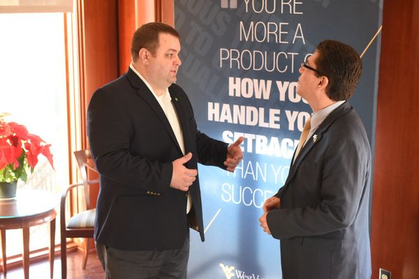 Huntington's regional president for West Virginia, left, talks with Javier Reyes, dean of the WVU John Chambers College of Business and Economics. Huntington presented a gift of $2 million to the business school on Dec. 18 for its Startup Engine.