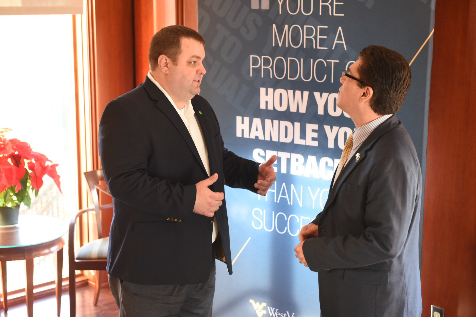Huntington's regional president for West Virginia, left, talks with Javier Reyes, dean of the WVU John Chambers College of Business and Economics. Huntington presented a gift of $2 million to the business school on Dec. 18 for its Startup Engine business accelerator.