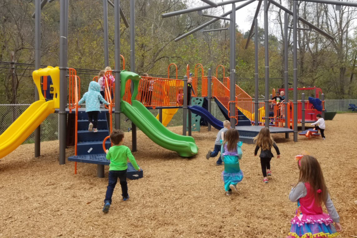 Children gather on a playground