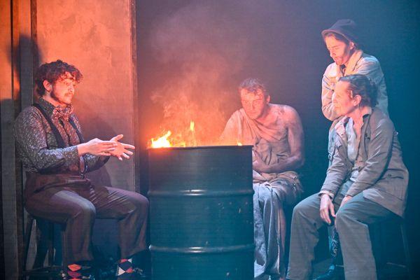 Men and women sitting around a fire