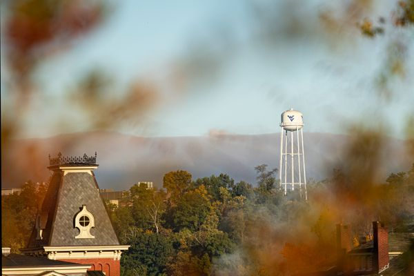 cupola in foreground of water tower in a distance