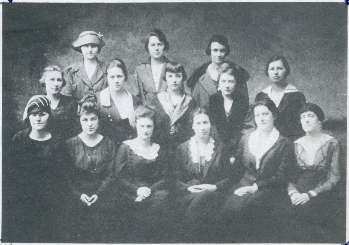 Woman in period era clothing pose, black and white picture taken during women's suffrage movement.