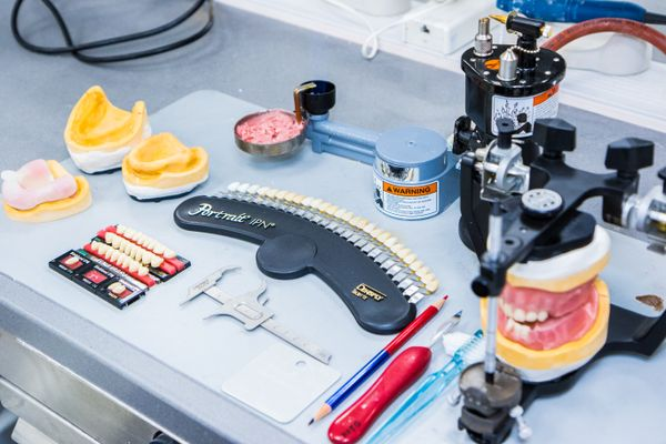 table of dentistry tools, including sets of teeth