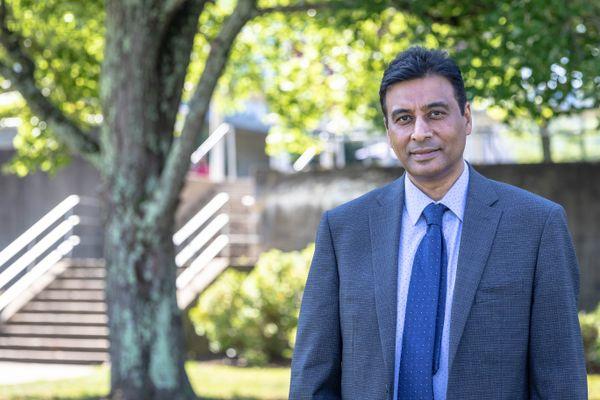 Man in grey suit, blue tie