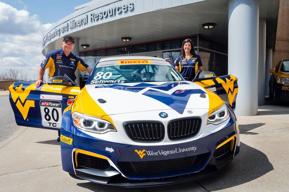 BMW car painted with WVU logos outside of the Davis College building