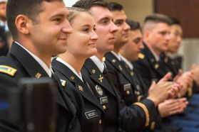 men and women in uniform stand in a line