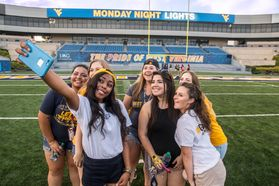 Class of 2020 members from left: Juana Baires, Asia Taylor, Nicole Gowland; Olivia Van Hoff, Sophia Keith, Jonnie Upton, Madison O'Donnell, Kerilynn Willemsen pose for a selfie as they attend Monday Night Lights during Welcome Week 2016.