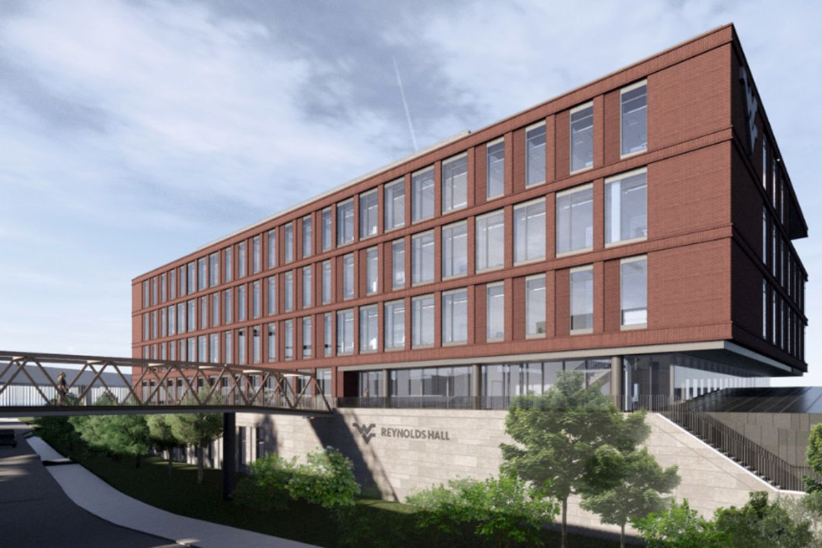 rendering of large brick building with elevated walkway