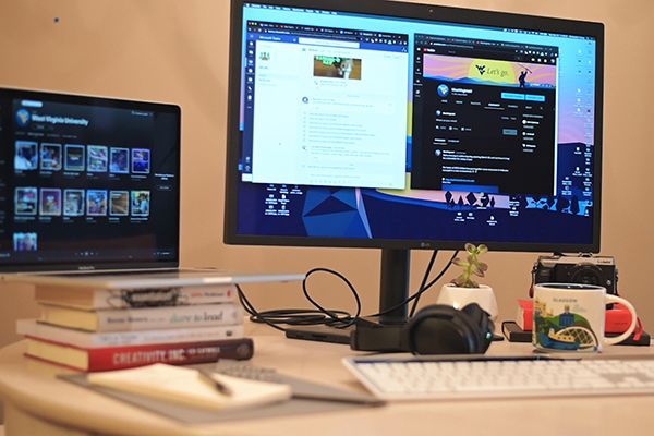 photo of computer and home desk