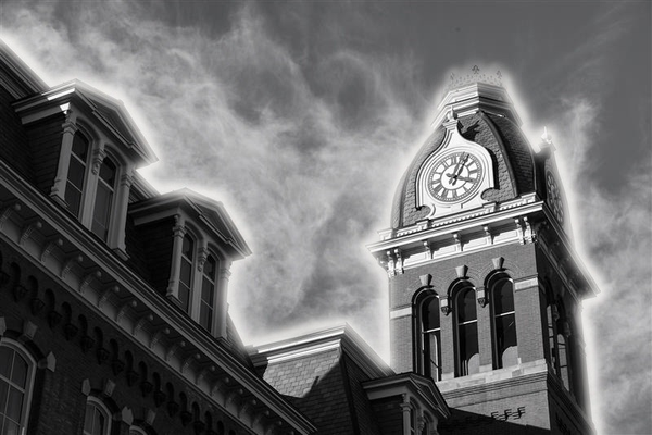 An ominous photo of Woodburn Hall with a glowing light around it
