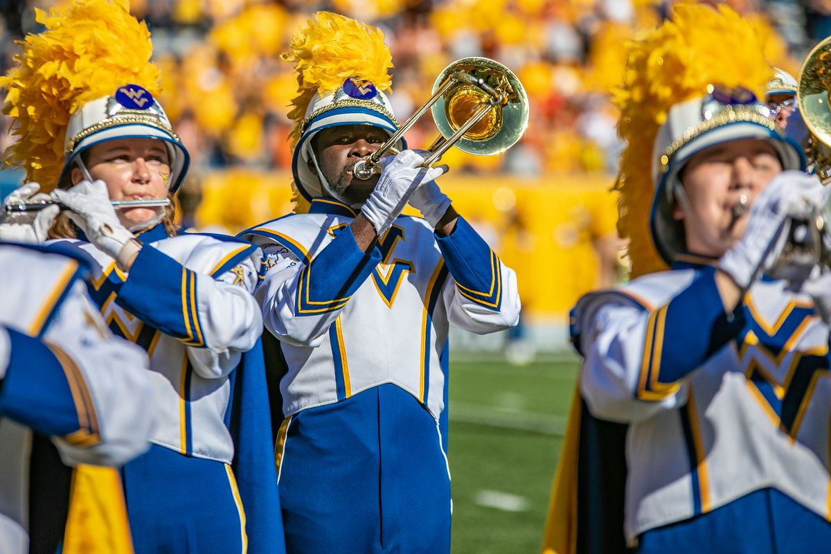 marching band members hold trombone and flute