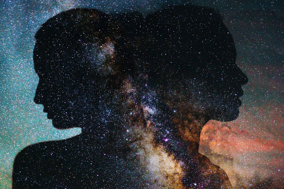 Illustration of two silhouettes in front of a galaxy