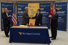 WVU Vice President for Research Fred King shakes hands with Cao Yang, chairman and CEO of Shanxi International Energy Group Company, Ltd., at a signing ceremony for expanded cooperation in clean energy research, training and education.