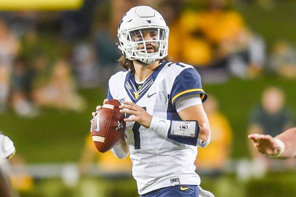 Will Grier getting ready to throw a football.