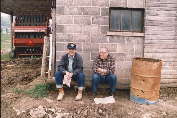 Men sitting outside a building