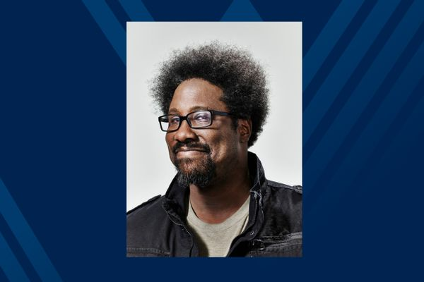 Man smiling posed in glasses