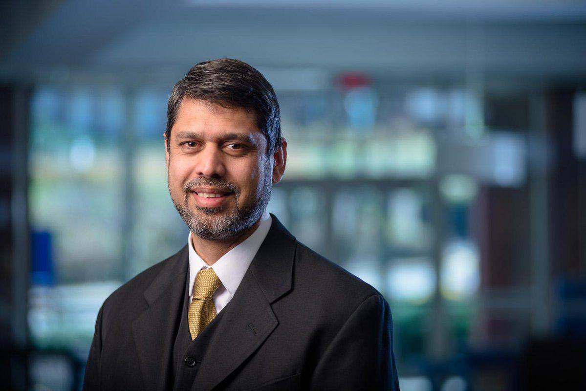 man in suit in tie, blurred background