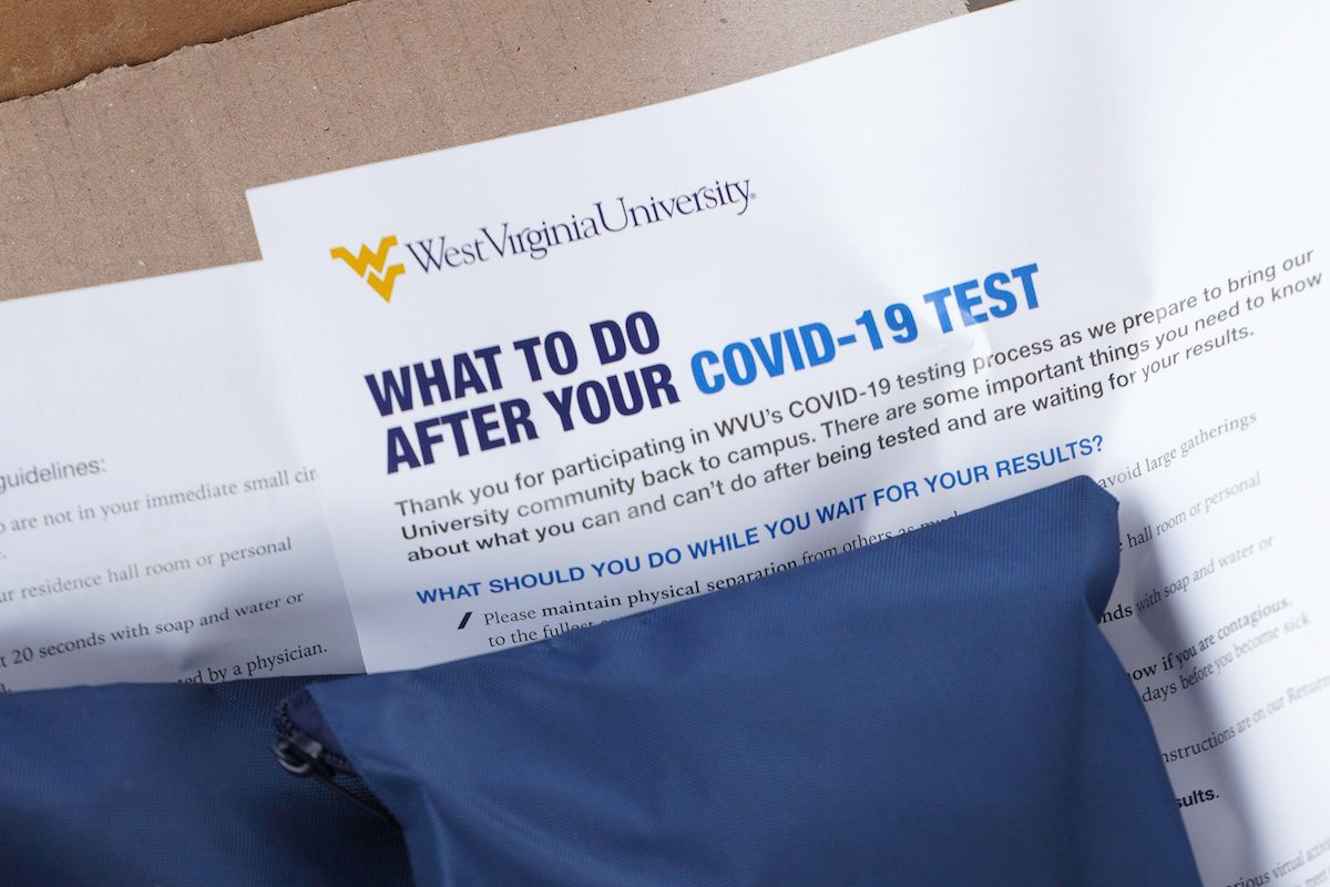 WHAT TO DO AFTER YOUR COVID-19 TEST on paper under blue packet