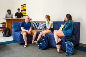 Students hang out on couches in University Hall common space.