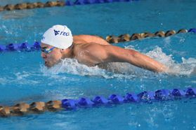 Student athlete swimmer performing butterfly stroke