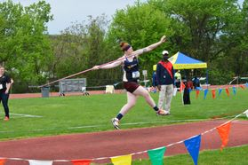 Student athlete throws javelin