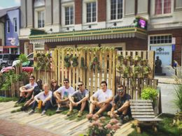 Landscape architecture students sitting on patio