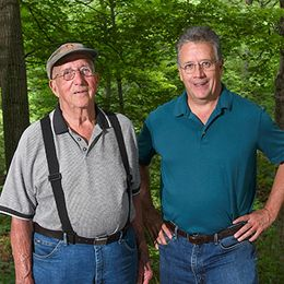 Richard (Dick) and Floyd Bowlby standing in forest