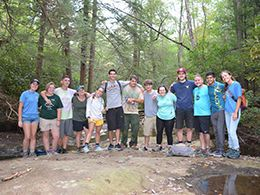 Recreation and Parks students posing for a picture in the woods