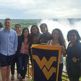Students holding a WVU flag