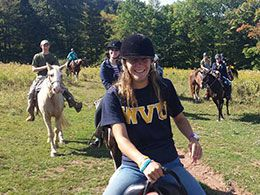 Several students on horseback
